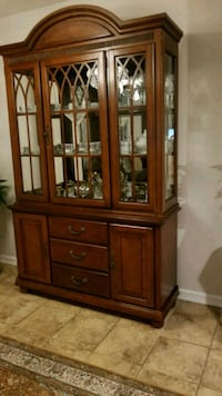 brown wooden framed glass china cabinet Edmonton, T6V 1W2