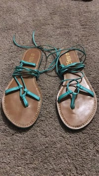 Pair of brown-and-green leather sandals Manassas