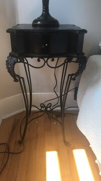 black metal base with brown wooden top table