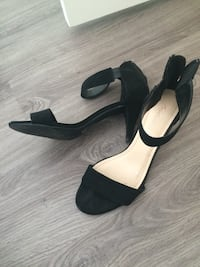 pair of black-and-brown buckle strap peep toe kitten heels