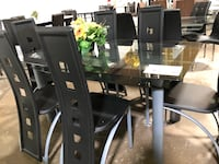 Glass dining table with 6 chairs. Brand new.  Allen