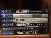 Sony PS4 Console with two controllers and many games Calgary, T2W 3P7