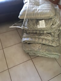 Green and white comforter and shans and pillows queen size