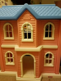 brown and white house miniature 27 km