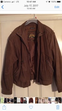 Worn a couple of times. Real leather!! This is a great jacket that I have no more room for. Inside pockets as well as outside pockets. Brand name in jackets.  Lexington, 40515