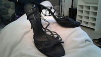 pair of black open-toe ankle-strap heel sandals