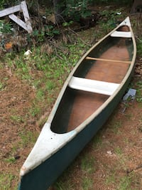 Green canoe 17ft comes with 2 sets paddles Auburn, 03032