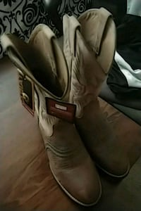 pair of gray leather cowboy boots Las Vegas, 89108