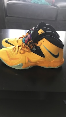 Pair of yellow-and-black Nike sneakers