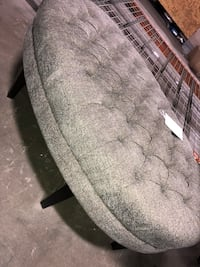 Oval tufted gray ottoman with black wooden base Houston, 77055