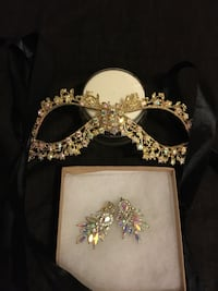 gold and diamond embellished earrings and mask