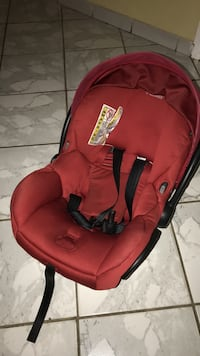baby's red and black car seat carrier Miami, 33184