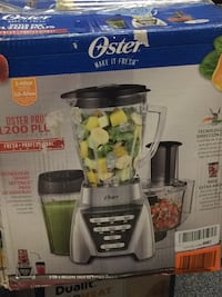 stainless steel and black oster blender and food processor box
