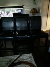 black wooden TV stand with flat screen television