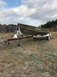 Jon boat with trolling motor and battery and trailer