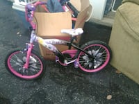toddler's pink and white bicycle 308 mi