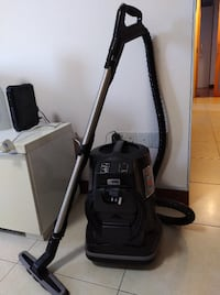 black and gray canister vacuum cleaner null