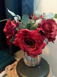 clear glass vase with red roses