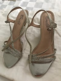 pair of gray leather open-toe ankle strap heels New York, 10036