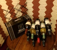 New table top wine rack, holds 10 bottles of wine, Retail $35. !
