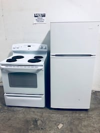 white and black electric coil range oven Toronto, M6B 3Y1