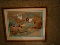 brown wooden framed painting of man Tampa, 33617