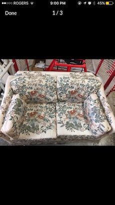 white, green, and red floral love seat