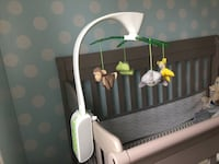 white and green crib mobile