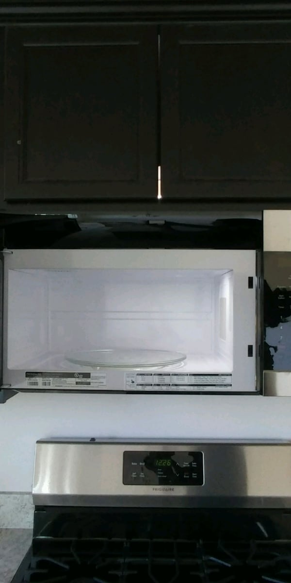 Frigidaire over the range microwave never used db2785df-5591-4190-85f8-cd46372b832b