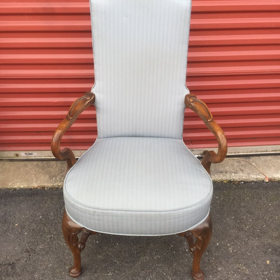 White and brown wooden armchair