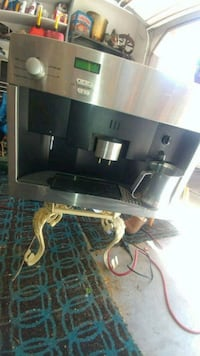 black flat screen TV with black wooden TV stand Boise, 83704