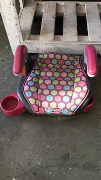 baby's pink and black graco booster seat