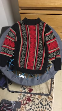 red and multicolored crew-neck sweater