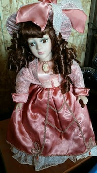 black haired doll wearing pink dress Culdesac, 83524