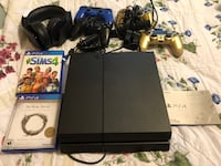 black Sony PS4 console with controller and game cases HERNDON