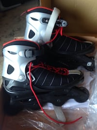 Black gray red inline skates...never worn.....