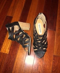 pair of black leather open-toe heeled sandals CALGARY