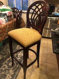 Two solid cherry wood framed padded chairs New York, 11209