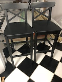 two black wooden armless chairs North Lauderdale, 33068