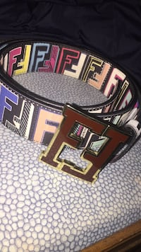 black and multicolored Fendi monogrammed leather belt with red buckle
