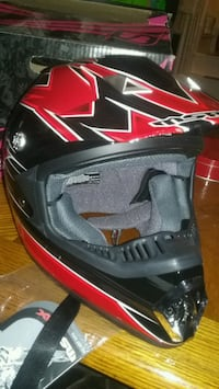 black and red msr  velocity motocross helmet.