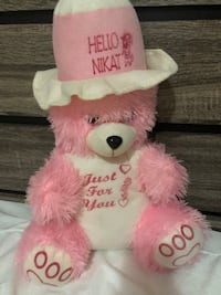 pink and white bear plush toy