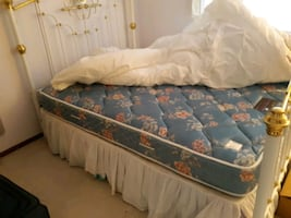 bed with frame, sheets and pillows