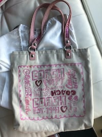 beige and pink Coach fabric tote bag