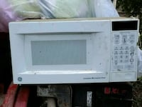 white General Electric microwave oven Commerce, 30529