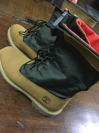 pair of brown Timberland work boots 45 km