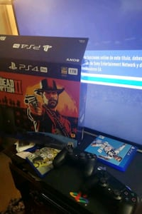 black Sony PS4 with game cases Austin, 78753