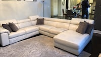 White leather couch was 8000 dollars 592 mi