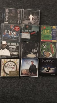 assorted CDs game cases etc