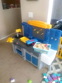Child's play work bench with play wood and screews.